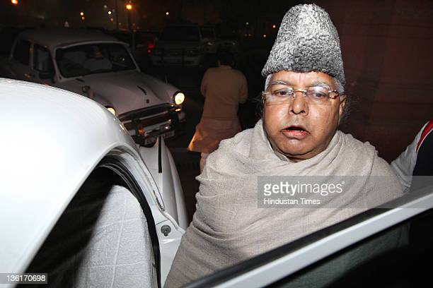 Rashtriya Janta Dal Chief Lalu Prasad Yadav walks out during the discussion on Lokpal Bill in Lok Sabha at Parliament house on December 27 2011 in...
