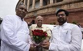 Rashtriya Janta Dal MPs Prem Chand Gupta and Jai Prakash Narayan Yadav welcome newly Rajya Sabha MP Ram Jethmalani during the Parliament Monsoon...