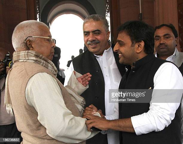 Rashtriya Janta Dal President Lalu Prasad Yadav talking with Samajwadi Party MP Akhilesh Yadav at Parliament House during the ongoing parliamentary...