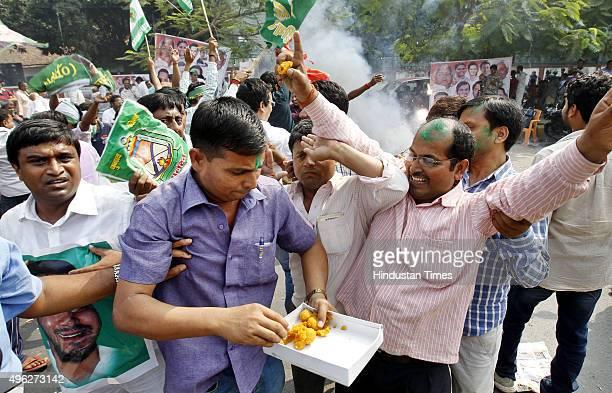 Rashtriya Janta Dal supporters celebrate landslide victory in Bihar Assembly elections at RJD Office on November 8 2015 in Patna India Nitish Kumar...