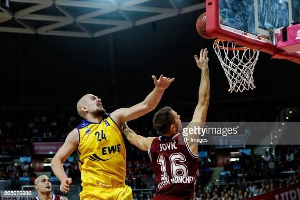 Rasid Mahalbasic of Oldenburg and Stefan Jovic of Bayern Muenchen battle for the ball during the easyCredit BBL Basketball Bundesliga match between...