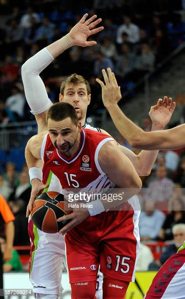 Rasko Katic #15 of Crvena Zvezda Telekom Belgrade competes with Andres Nocioni #5 of Laboral Kutxa Vitoria during the 20132014 Turkish Airlines...