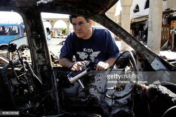 Rasmi Watad from Israel looks inside his burnt out car at the Tiran Centre in the old Town of Sharm after it was bombed One Briton is known to have...