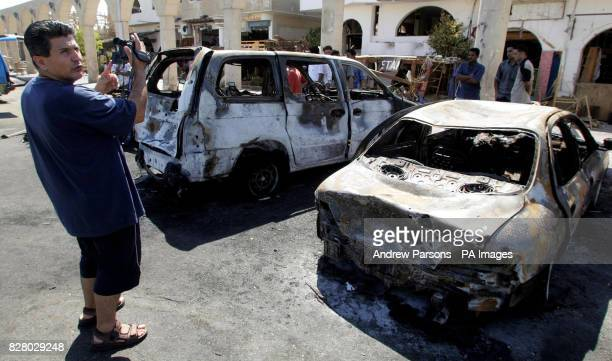 Rasmi Watad from Israel videos his burnt out car far at the Tiran Centre in the old Town of Sharm after it was bombed One Briton is known to have...