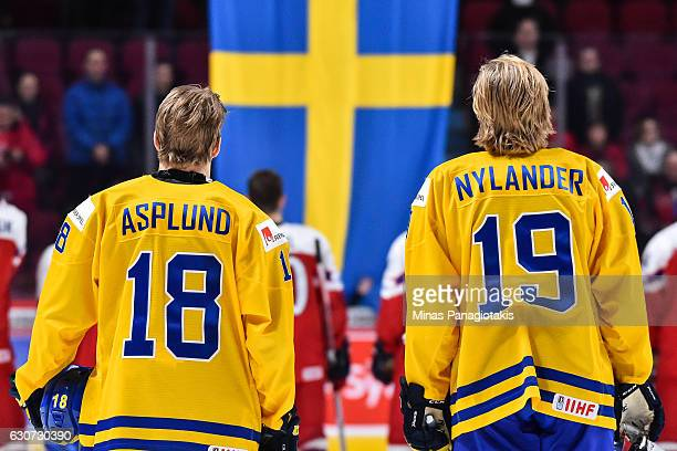 Rasmus Asplund and Alexander Nylander of Team Sweden watch as the Swedish flag is raised after defeating Team Czech Republic during the 2017 IIHF...