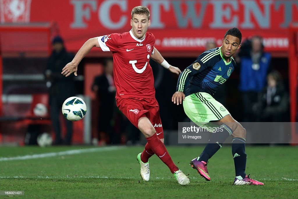 Rasmus Bengtsson of FC Twente (L) Danny Hoesen of Ajax (R) during the Dutch Eredivisie match between FC Twente and Ajax Amsterdam at the Grolsch Veste on march 02, 2013 in Enschede, The Netherlands