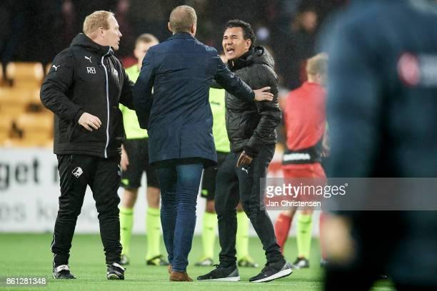 Rasmus Bertelsen assistant coach of Randers FC Michael Gravgaard Manager of Randers FC and Ricardo Moniz head coach of Randers FC in discussion after...