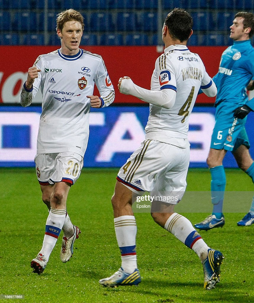 Rasmus Elm of PFC CSKA Moscow (L) celebrates his goal during the Russian Football League Championship match between FC Zenit St. Petersburg and PFC CSKA Moscow at the Petrovsky Stadium on November 26, 2012 in St. Petersburg, Russia.