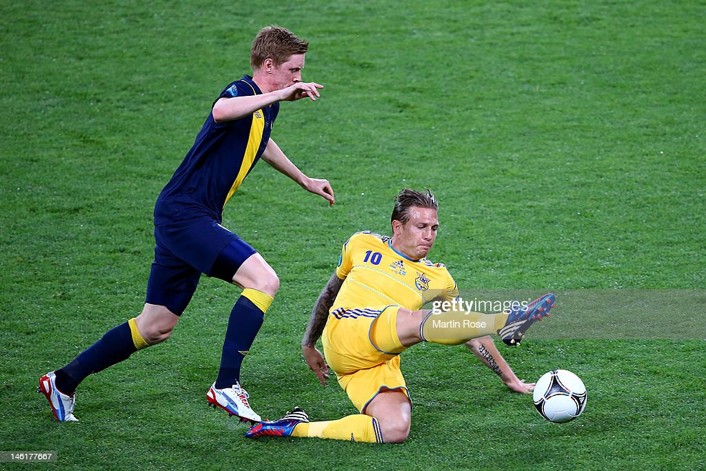 Rasmus Elm of Sweden and Andriy Voronin of Ukraine compete for the ball during the UEFA EURO 2012 group D match between Ukraine and Sweden at The...