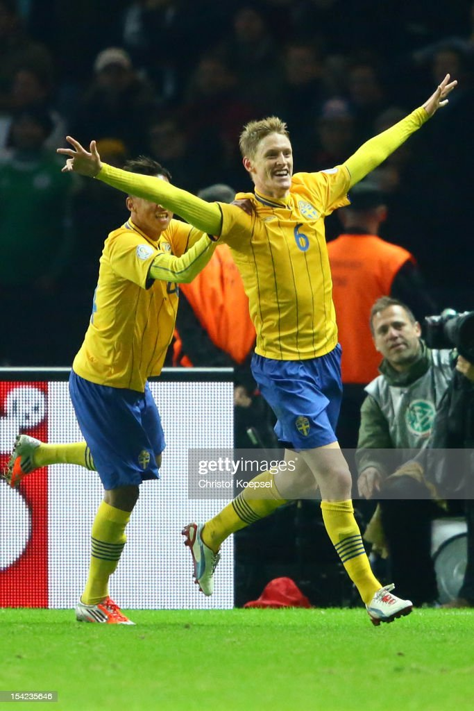 Rasmus Elm of Sweden (R) celebrates the forth goal with <a gi-track='captionPersonalityLinkClicked' href=/galleries/search?phrase=Johan+Elmander&family=editorial&specificpeople=553763 ng-click='$event.stopPropagation()'>Johan Elmander</a> (L) during the FIFA 2014 World Cup qualifier group C match between German and Sweden at Olympiastadion on October 16, 2012 in Berlin, Germany.