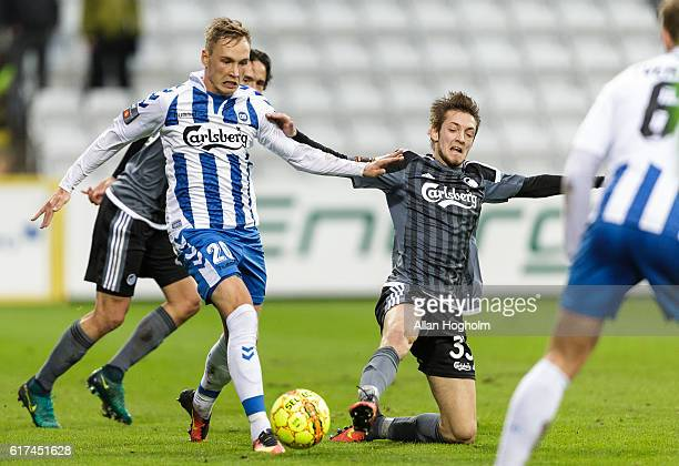 Rasmus Falk of FC Copenhagen and Jacob Barrett Laursen of OB compete for the ball during the Danish Alka Superliga match between OB Odense and FC...