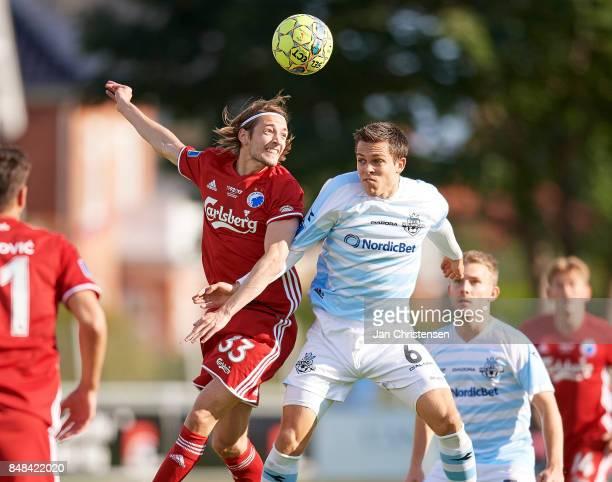 Rasmus Falk of FC Copenhagen and Mikkel Basse of FC Helsingor compete for the ball during the Danish Alka Superliga match between FC Helsingor and FC...