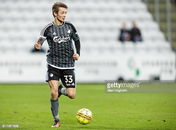 Rasmus Falk of FC Copenhagen controls the ball during the Danish Alka Superliga match between OB Odense and FC Copenhagen at EWII Park on October 23...