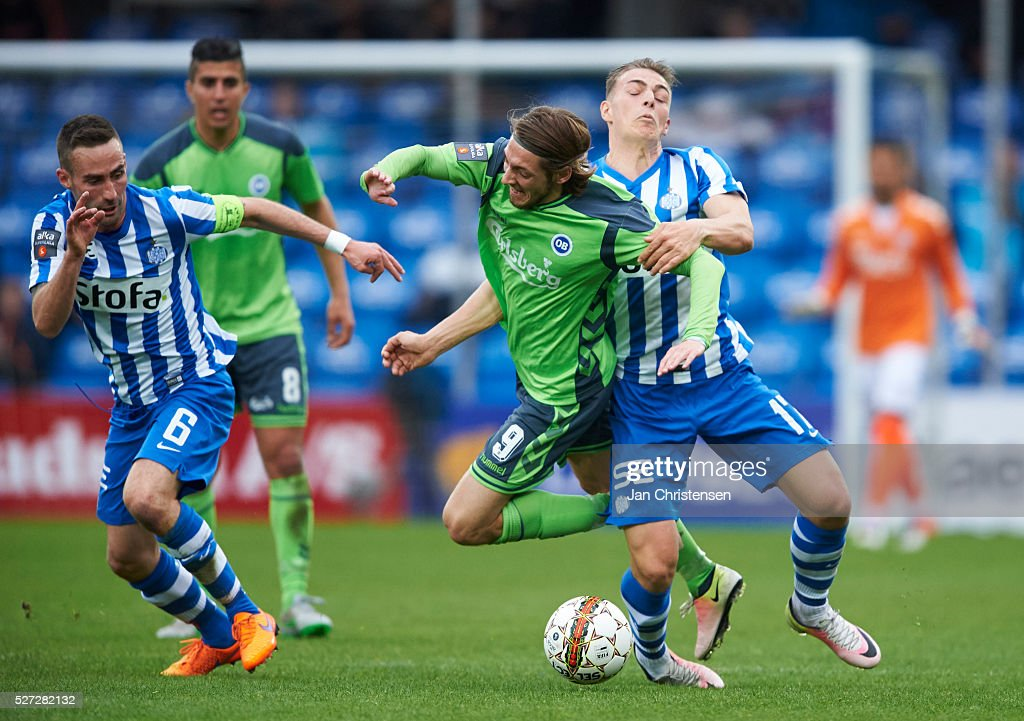 Rasmus Falk of OB Odense and Casper Nielsen of Esbjerg fB compete for the ball during the Danish Alka Superliga match between Esbjerg fB and OB Odense at Blue Water Arena on May 02, 2016 in Esbjerg, Denmark.