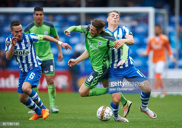 Rasmus Falk of OB Odense and Casper Nielsen of Esbjerg fB compete for the ball during the Danish Alka Superliga match between Esbjerg fB and OB...