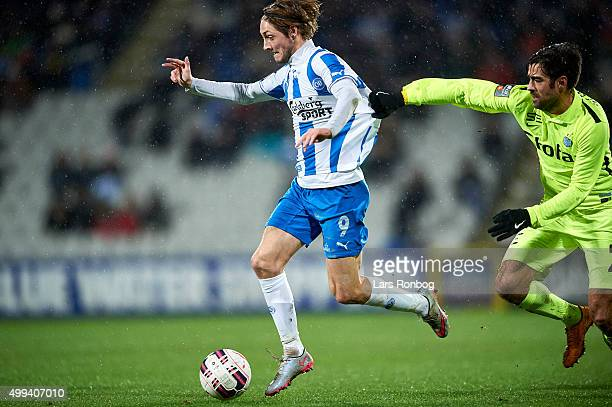 Rasmus Falk of OB Odense and Jerry Lucena of Esbjerg fB compete for the ball during the Danish Alka Superliga match between OB Odense and Esbjerg fB...