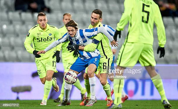 Rasmus Falk of OB Odense and Magnus Lekven of Esbjerg fB compete for the ball during the Danish Alka Superliga match between OB Odense and Esbjerg fB...