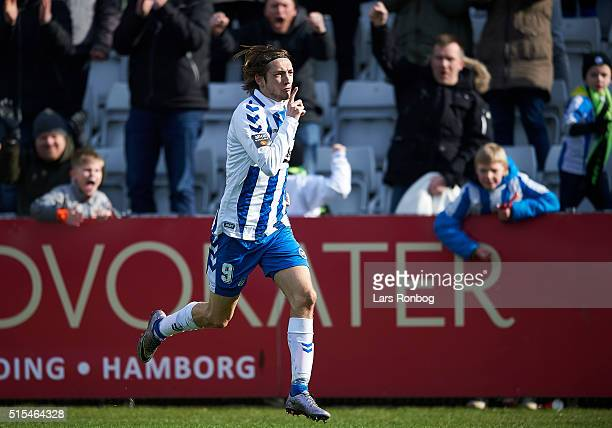 Rasmus Falk of OB Odense celebrates after scoring their third goal during the Danish Alka Superliga match between OB Odense and FC Nordsjalland at...