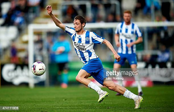 Rasmus Falk of OB Odense controls the ball during the Danish Alka Superliga match between OB Odense and Silkeborg IF at TreFor Park on May 20 2015 in...
