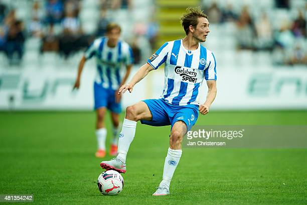 Rasmus Falk of OB Odense controls the ball during the Danish Alka Superliga match between OB Odense and Hobro IK at TREFOR Park on July 19 2015 in...