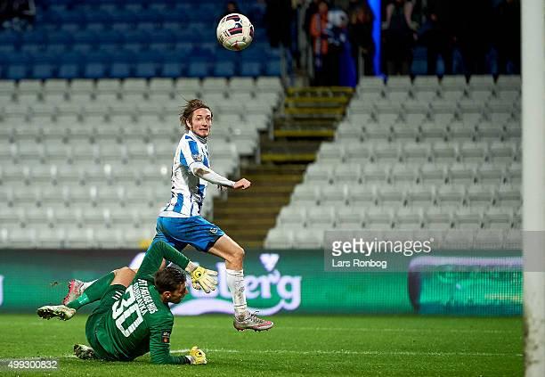 Rasmus Falk of OB Odense scores the 21 goal against Goalkeeper Martin Dubravka of Esbjerg fB during the Danish Alka Superliga match between OB Odense...