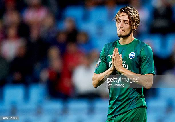 Rasmus Falk of OB Odense shows frustration during the Danish Alka Superliga match between AaB Aalborg and OB Odense at Nordjyske Arena on August 24...