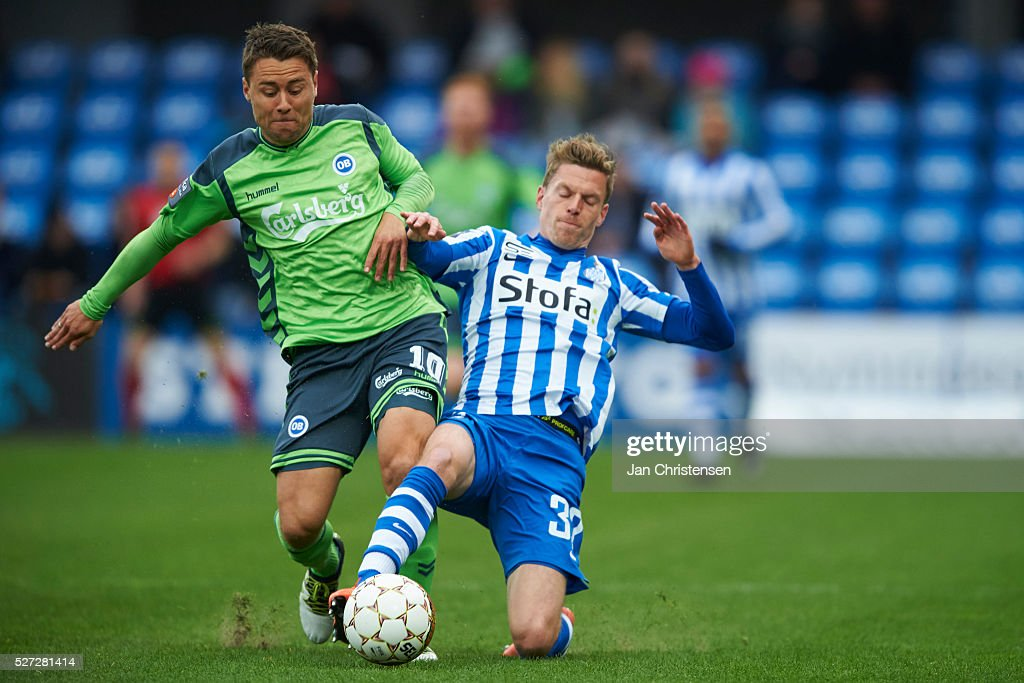 Rasmus Festersen of OB Odense and Nikolaj Hagelskjar of Esbjerg fB compete for the ball during the Danish Alka Superliga match between Esbjerg fB and OB Odense at Blue Water Arena on May 02, 2016 in Esbjerg, Denmark.