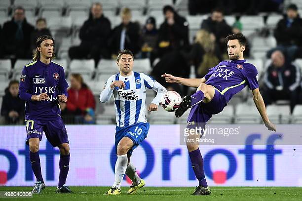 Rasmus Festersen of OB Odense and Tim Sparv of Midtjylland compete for the ball during the Danish Alka Superliga match between OB Odense and FC...