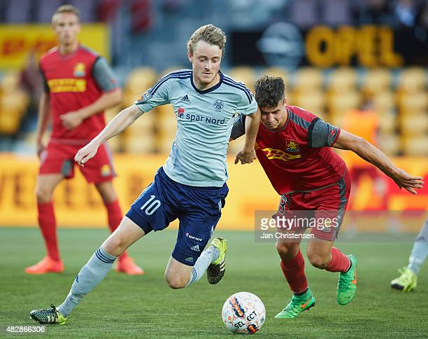 Rasmus Jonsson of AaB Aalborg and Emiliano Marcondes Hansen of FC Nordsjalland compete for the ball during the Danish Alka Superliga match between FC...