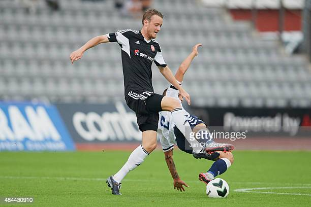 Rasmus Jonsson of AaB Aalborg compete for the ball during the Danish Alka Superliga match between AGF Arhus and AaB Aalborg at Ceres Park on August...