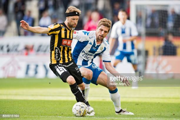 Rasmus Lindgren of BK Hacken and Mikael Boman of IFK Goteborg competes for the ball during the Allsvenskan match between IFK Goteborg and BK Hacken...