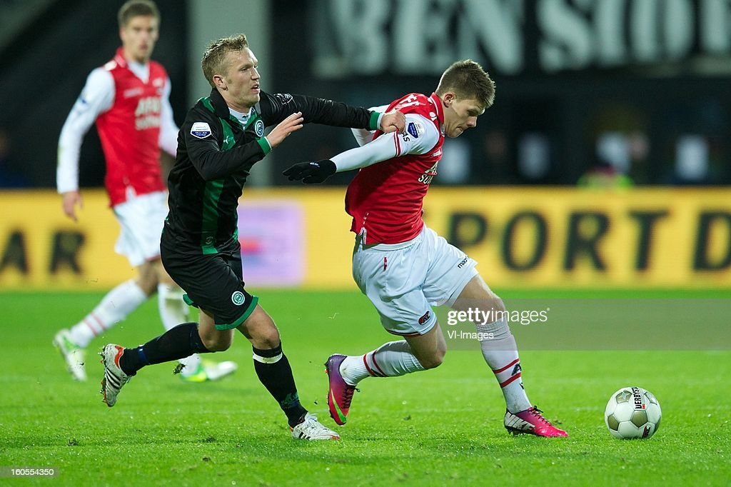 Rasmus Lindgren of FC Groningen, Johann Berg Gudmundsson of AZ during the Dutch Eredivisie match between AZ Alkmaar and FC Groningen at the AFAS Stadium on february 2, 2013 in Alkmaar, The Netherlands