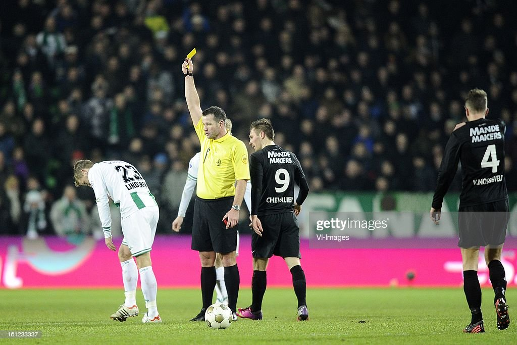 Rasmus Lindgren of FC Groningen, Referee Pieter Vink, Teddy Chevalier of RKC Waalwijk, Frank van Mosselveld of RKC Waalwijk, during the Dutch Eredivisie match between FC Groningen and RKC Waalwijk at the Euroborg on february 9, 2013 in Groningen, The Netherlands