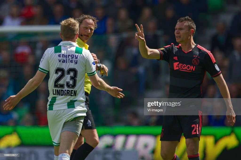 Rasmus Lindgren of FC Groningen, referee Reinold Wiedemeijer, Derk Boerrigter of Ajax during the Dutch Eredivisie match between FC Groningen and Ajax on May 12, 2013 at the Euroborg stadium in Groningen, The Netherlands.