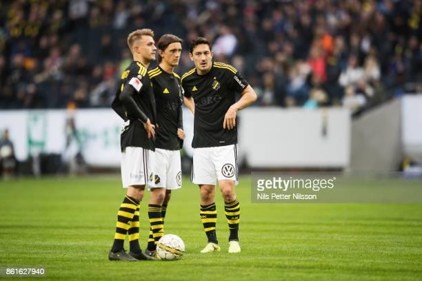 Rasmus Lindkvist Kristoffer Olsson and Stefan Ishizaki of AIK before a free kick during the Allsvenskan match between AIK and Jonkopings Sodra IF at...