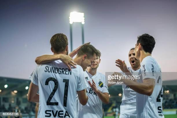 Rasmus Lindkvist of AIK celebrates with teammates after scoring 16 during the Allsvenskan match between BK Hacken and AIK at Bravida Arena on...