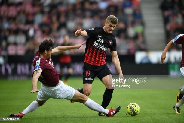 Rasmus Minor Petersen of Hobro IK and Alexander Sorloth of FC Midtjylland compete for the ball during the Danish Alka Superliga match between FC...