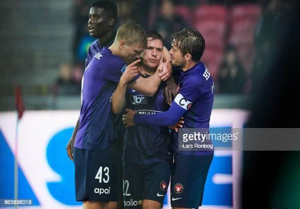 Rasmus Nissen Mikkel Duelund and Jakob Poulsen of FC Midtjylland celebrate after scoring their third goal during the Danish Alka Superliga match...