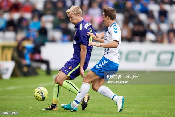 Rasmus Nissen of FC Midtjylland and Casper Nielsen of OB Odense compete for the ball during the Danish Alka Superliga match between OB Odense and FC...
