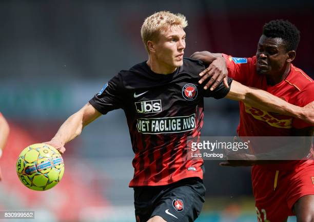 Rasmus Nissen of FC Midtjylland and Godsway Donyoh of FC Nordsjalland compete for the ball during the Danish Alka Superliga match between FC...