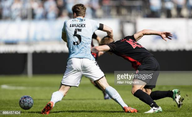 Rasmus Nissen of FC Midtjylland and Kees Luijckx of SonderjyskE compete for the ball during the Danish Alka Superliga match between FC Midtjylland...