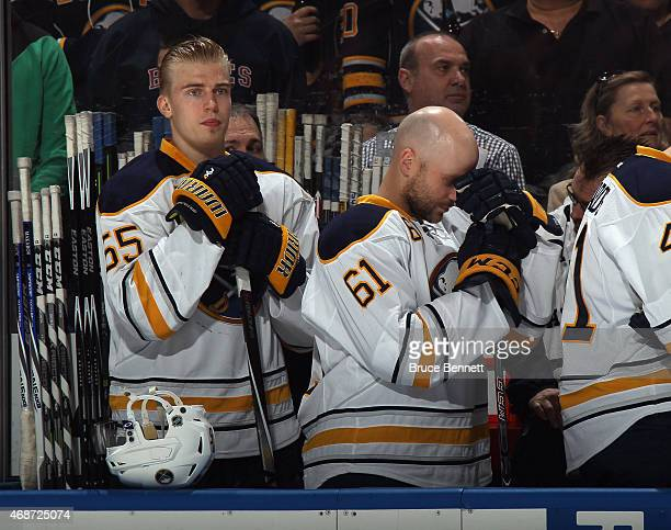 Rasmus Ristolainen and Andre Benoit of the Buffalo Sabres prepare to play against the New York Islanders at the Nassau Veterans Memorial Coliseum on...