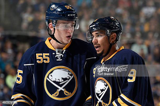 Rasmus Ristolainen and Evander Kane of the Buffalo Sabres talk inbetween whistles during the game against the Ottawa Senators at the First Niagara...