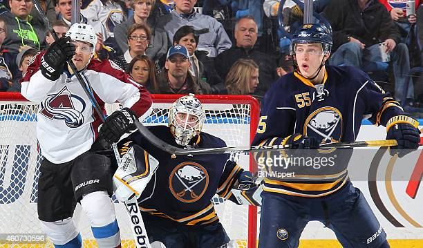 Rasmus Ristolainen and Jhonas Enroth of the Buffalo Sabres and Daniel Briere of the Colorado Avalanche kepp a close eye on the puck on December 20...
