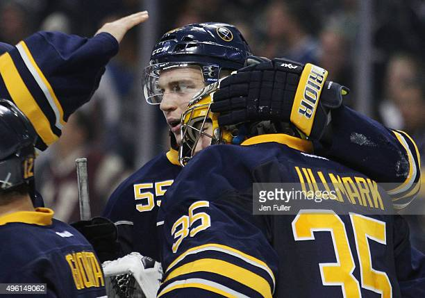 Rasmus Ristolainen and Linus Ullmark of the Buffalo Sabres celebrate their 32 victory over the Vancouver Canucks at First Niagara Center on November...