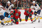 Rasmus Ristolainen and Nikita Zadorov of the Buffalo Sabres battle for the puck with Erik Haula and Jordan Schroeder of the Minnesota Wild during the...