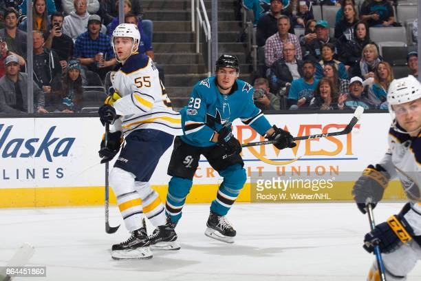 Rasmus Ristolainen of the Buffalo Sabres and Timo Meier of the San Jose Sharks look at SAP Center on October 12 2017 in San Jose California