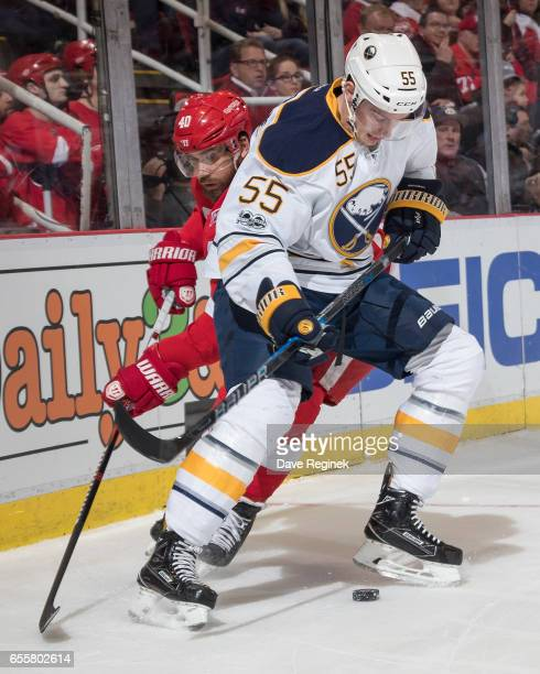 Rasmus Ristolainen of the Buffalo Sabres battles for the puck with Henrik Zetterberg of the Detroit Red Wings during an NHL game at Joe Louis Arena...