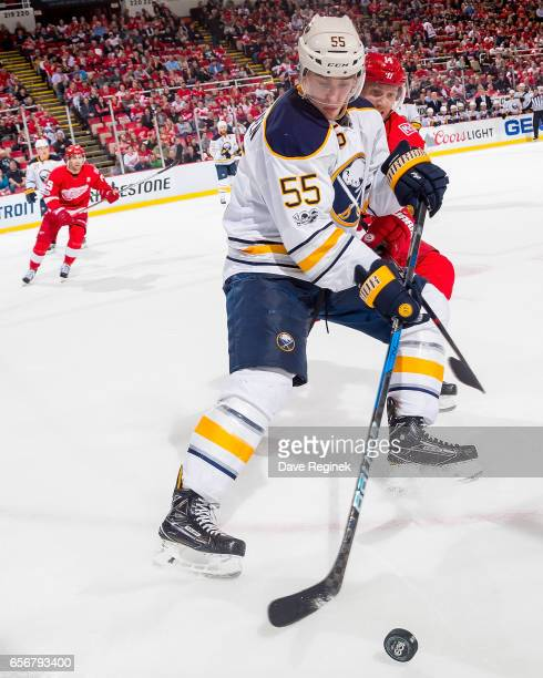 Rasmus Ristolainen of the Buffalo Sabres battles for the puck with Gustav Nyquist of the Detroit Red Wings during an NHL game at Joe Louis Arena on...