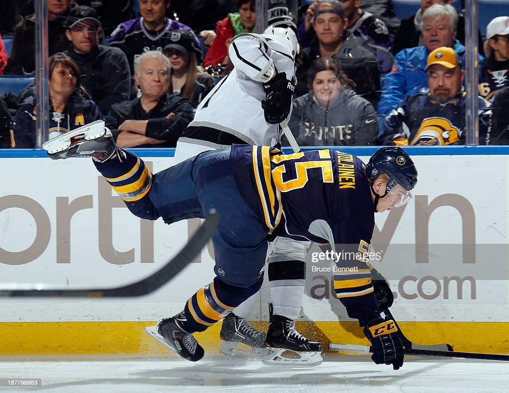 Rasmus Ristolainen #55 of the Buffalo Sabres bounces off Anze Kopitar #11 of the Los Angeles Kings during the first period at the First Niagara Center on November 12, 2013 in Buffalo, New York.